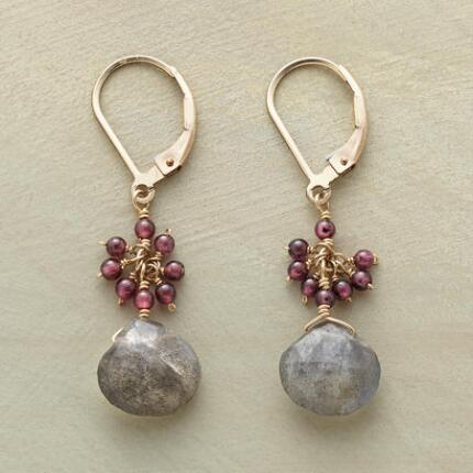 This pair of garnet and labradorite dangling earrings exudes a sense of lovely sophistication.