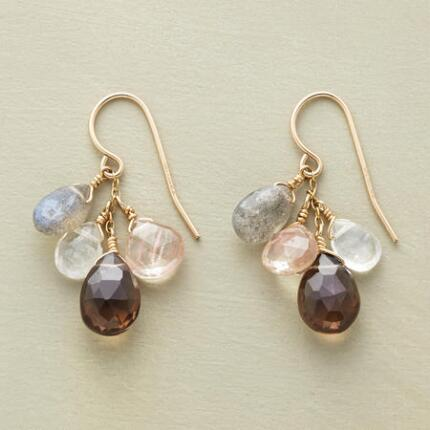 A pair of Thoi Vo dangling gemstone earrings that resembles the delicate hues of a dusky sky.