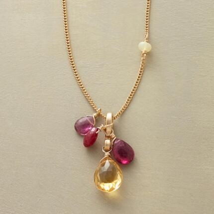 This ruby and citrine necklace embraces pink tourmaline and opal to make a charming impression.