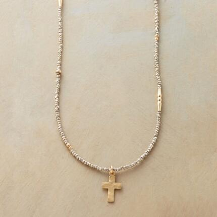 Our gently luminous carved cross necklace glows from end to end.