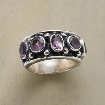 Add a regal element to your ensemble with this amethyst crown ring.