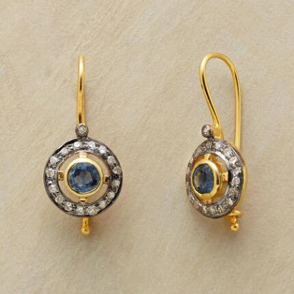 These diamond corona and sapphire earrings shine with an ornate refinement.