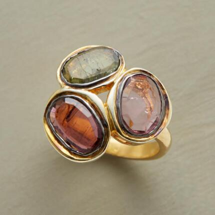 The earthy tones of this three pebble quartz ring complement the setting's brightness.