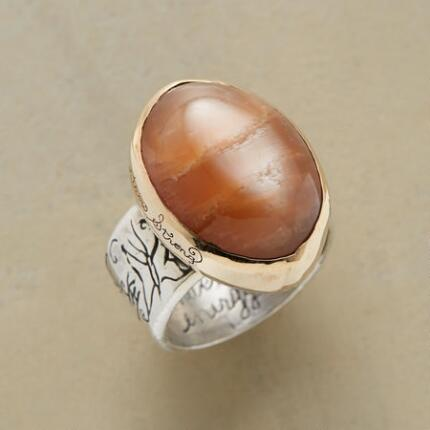 An enchanting peach moonstone magic ring that will have you under its spell.