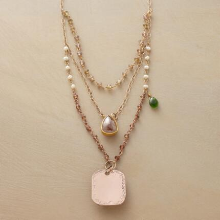 A Jes MaHarry personalized pendant necklace that simply glows with sumptuous grace.