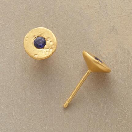 A pair of iolite golden disk earrings that contrasts bright and dark materials to stunning effect.