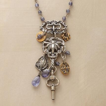 This iolite quartz and charm necklace makes a delicate yet distinctive statement.
