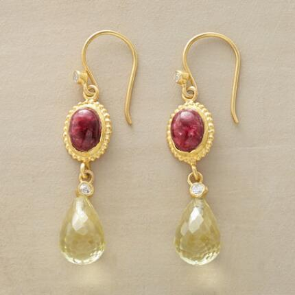 A pair of ornate topaz quartz and sillimanite earrings that emanate an ethereal spirit.