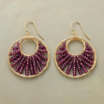 This pair of garnet beaded hoop earrings radiates a warm elegance.