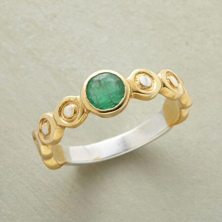 The lively colors of this handcrafted emerald ring will brighten any look.