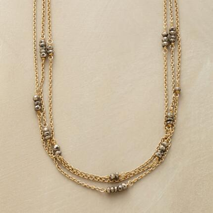 This three-strand pyrite necklace adds a glowing touch to any look.