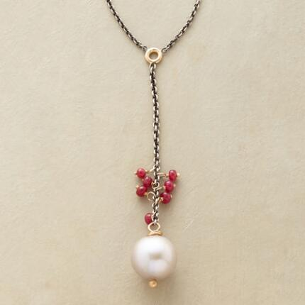 A ruby and pearl dangle necklace that makes a delicately gorgeous impression.