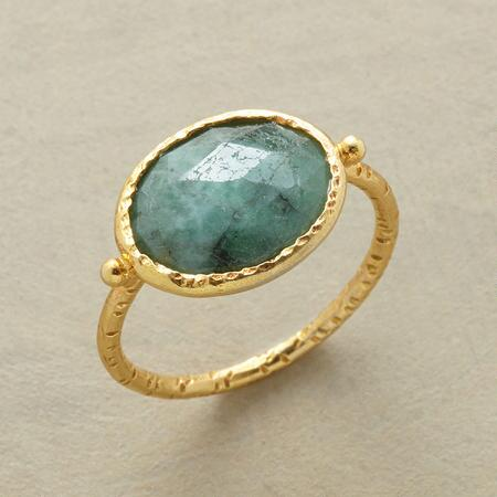 Once you've worn your hammered-bezel emerald ring, you'll never want to take it off.