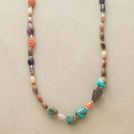 Shake things up with this rock on gemstone necklace, a colorful addition to any look.