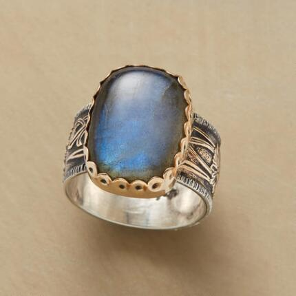 A silver art nouveau labradorite ring that glows with otherworldly color.