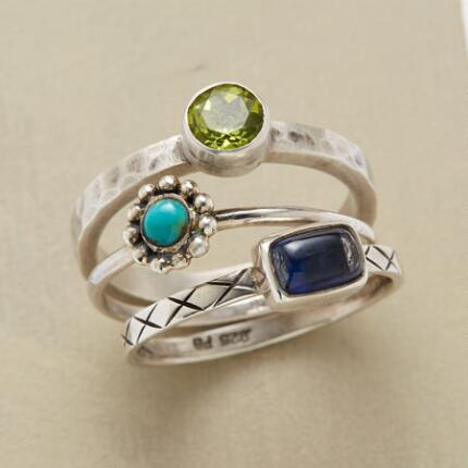 The three distinct bands that comprise this handcrafted gems ring combine to make a unique statement.