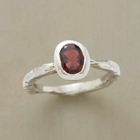 Flawless stone and rough-hewn metal make a stunning mix in this oval garnet ring.