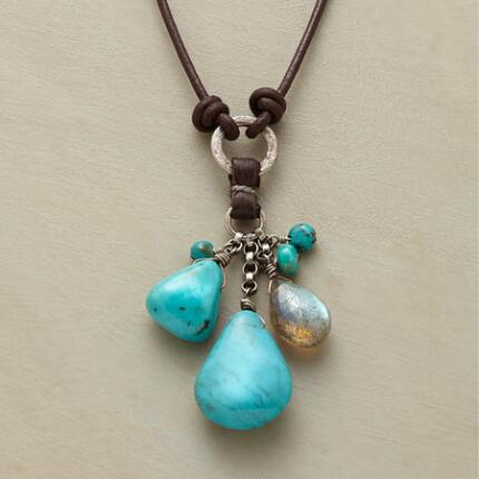 This richly colored turquoise and labradorite pendant necklace makes a vivid impression.