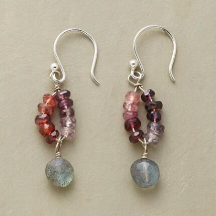 These handmade purple procession earrings assemble a lovely range of colors to vivid effect.