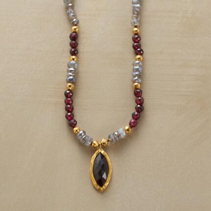 This handmade garnet pendant necklace is a sumptuously elegant piece.