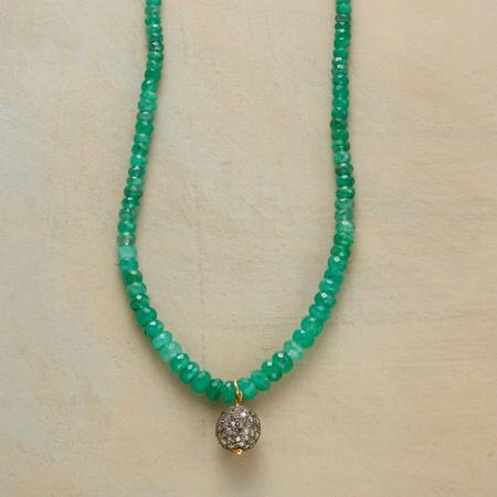 The beauty of this pavé diamond and emerald necklace is simply mesmerizing.