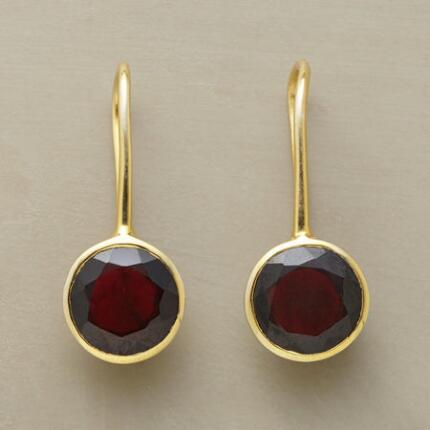 Our exclusive faceted garnet earrings catch light and set it aflame.