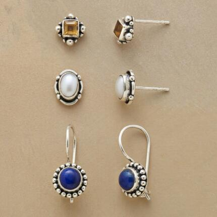 This set of three gemstone stud earrings features winsome, delicate details in sterling silver.