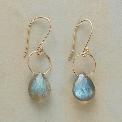 The gems in these dangling labradorite 14kt gold earrings swing freely, revealing their shifting colors.