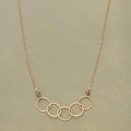 This 14kt gold linked rings necklace simply glows with timeless elegance.