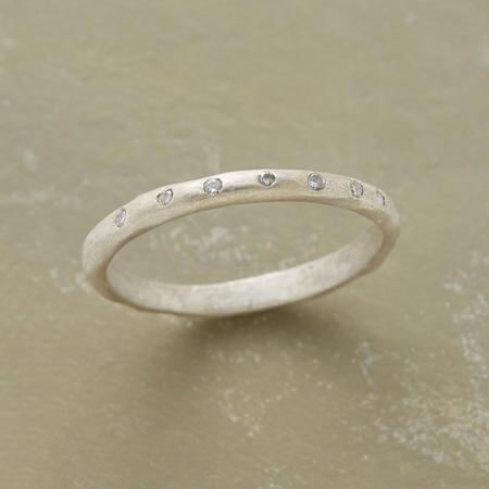Simple and sweet, this seven across diamond ring band will brighten any outfit.