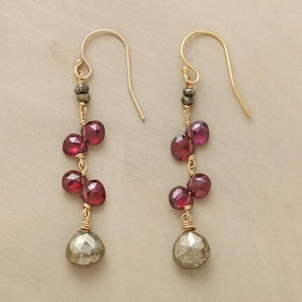 Dangling garnet and pyrite earrings that hang from the ear like the fruits of paradise.