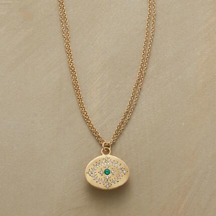 A gorgeous diamond and emerald gold pendant necklace, with all the brilliance of a wearable constellation.