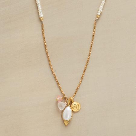 Delicately ornate, this pearl lotus and quartz necklace draws the eye with its lovely details.