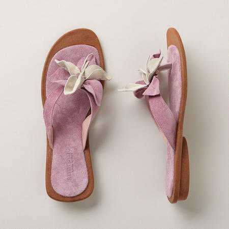 Bursting with beauty, these floral suede thong sandals will bring your look to life.