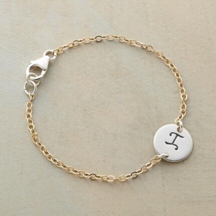 Graceful and distinctive, this personalized initial bracelet makes a special statement.