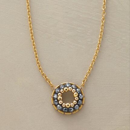 You'll love the simple elegance of this Miguel Ases beaded circle necklace.