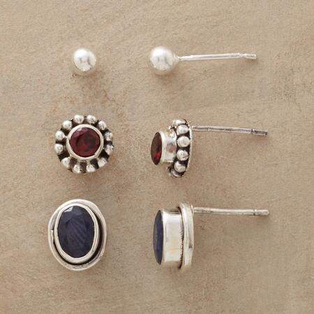 Pick your pleasure from among this sapphire, garnet and sterling earring set.