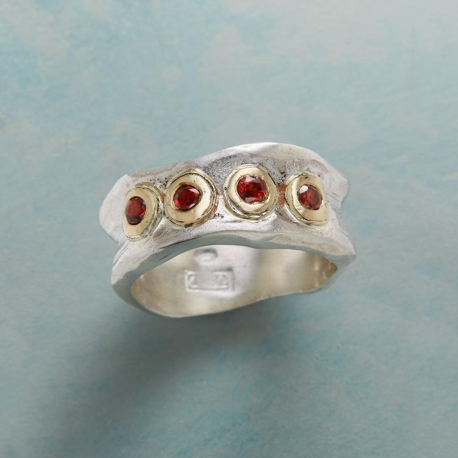 WAVERING GARNET RING