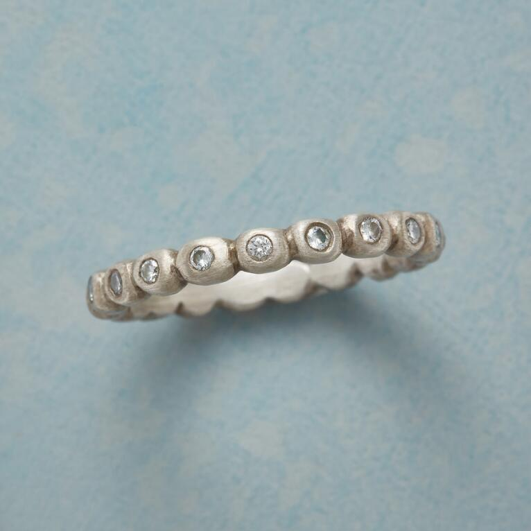 ENCIRCLED DIAMOND RING